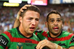 English international representative Sam Burgess, looking worse for wear with a busted cheekbone and eye socket, is congratulated for his efforts by team mate and Australian international representative Greg Inglis (GI)