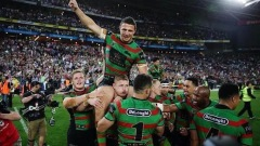 Sam, with broken cheekbone and eye socket is carried off the field in a pose reminiscent to Souths winning captain John Sattler who played the 1970 Grand Final with a badly broken jaw.