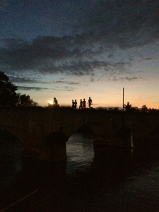 Silhouettes on the old railway bridge.
